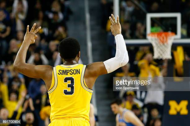 Michigan Wolverines guard Zavier Simpson celebrates hitting a threepoint shot during a regular season nonconference basketball game between the UCLA...