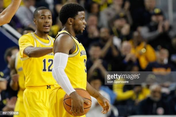 Michigan Wolverines guard Zavier Simpson holds the ball during a regular season nonconference basketball game between the UCLA Bruins and the...