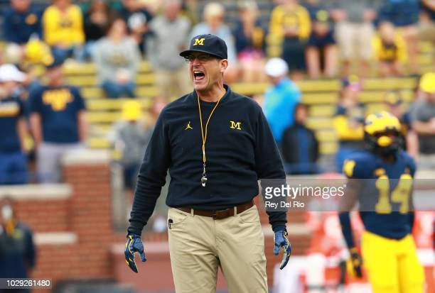 Michigan Wolverines head coach Jim Harbaugh during warms up with the team prior to the game against the Western Michigan Broncos at Michigan Stadium...
