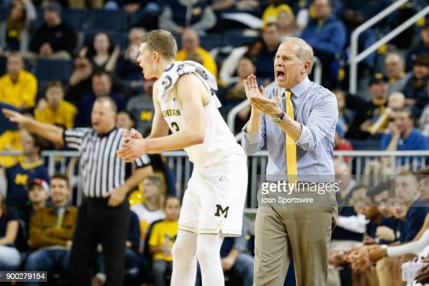 Michigan Wolverines head coach John Beilein cheers on this team during a regular season nonconference basketball game between the Jacksonville...