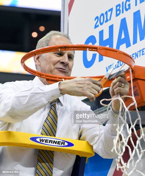 Michigan Wolverines head coach John Beilein cuts down the net following the Big 10 Tournament Championship game between the Michigan Wolverines and...