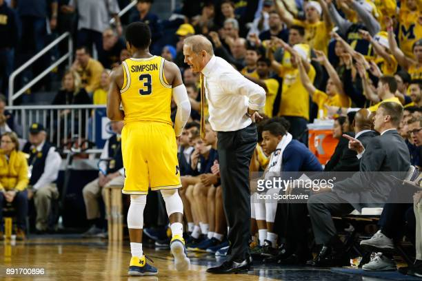 Michigan Wolverines head coach John Beilein talks to Michigan Wolverines guard Zavier Simpson during a regular season nonconference basketball game...