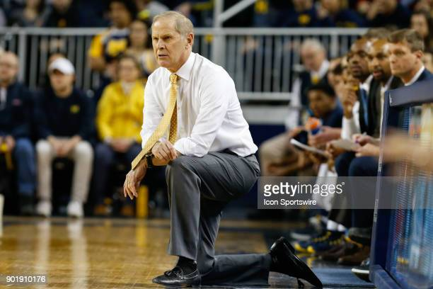 Michigan Wolverines head coach John Beilein watches the action on the court during the first half of a regular season Big 10 Conference basketball...