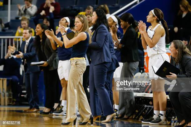 Michigan Wolverines head coach Kim Barnes Arico cheers on her team during a regular season Big 10 Conference basketball game between the Northwestern...