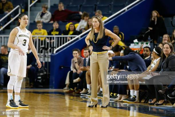 Michigan Wolverines head coach Kim Barnes Arico talks with Michigan Wolverines guard Katelynn Flaherty during the second half of a regular season Big...