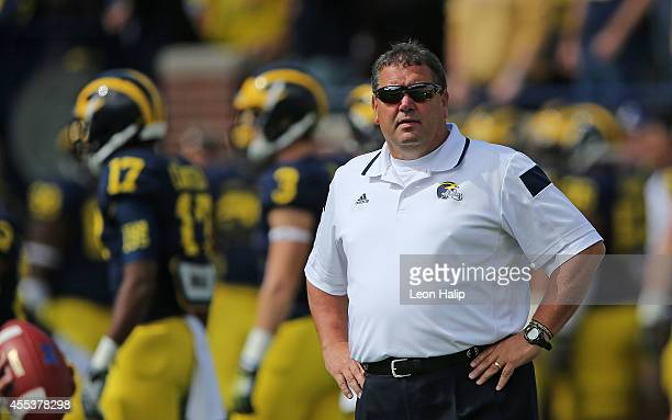 Michigan Wolverines head football coach Brady Hoke watches the pregame warm ups prior to the start of the game against the Miami Redhawks Michigan...