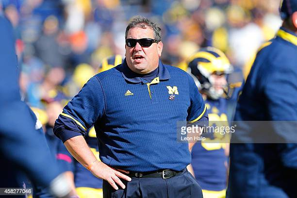 Michigan Wolverines head football coach Brady Hoke watches the pregame warm ups prior to the start of the game against the Indiana Hoosiers at...