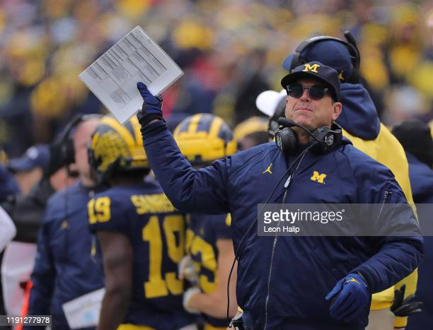 Michigan Wolverines Head Football Coach Jim Harbaugh reacts to a call during the second quarter of the game against the Ohio State Buckeyes at...