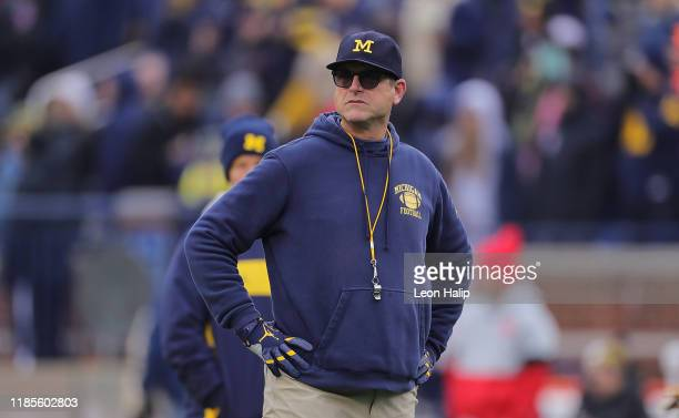 Michigan Wolverines Head Football Coach Jim Harbaugh watches the pregame warmups prior to the start of the game against the Ohio State Buckeyes at...