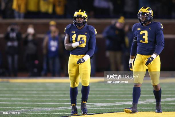 Michigan Wolverines linebacker Devin Bush and Michigan Wolverines defensive lineman Rashan Gary look on during a game between the Indiana Hoosiers...
