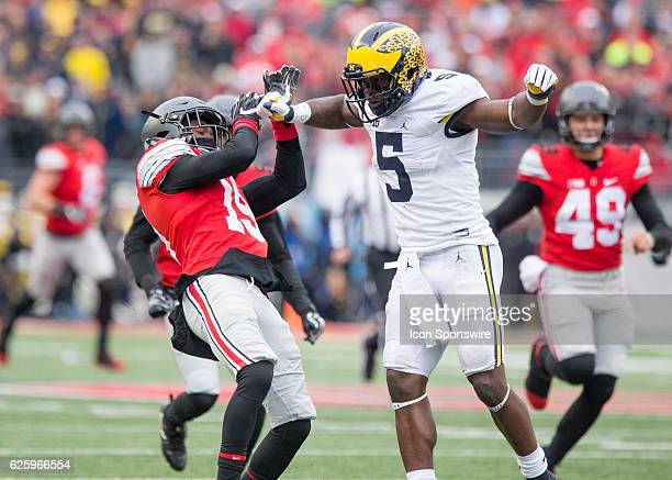 Michigan Wolverines linebacker Jabrill Peppers hits Ohio State Buckeyes safety Eric GloverWilliams during the second quarter on November 26 at Ohio...