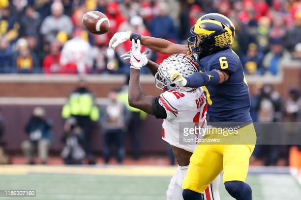 Michigan Wolverines linebacker Josh Uche breaks up a pass intended for Ohio State Buckeyes corner back Sevyn Banks during a regular season Big 10...