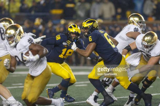 Michigan Wolverines linebacker Josh Uche plays defense during a nonconference game between the Notre Dame Fighting Irish and the Michigan Wolverines...