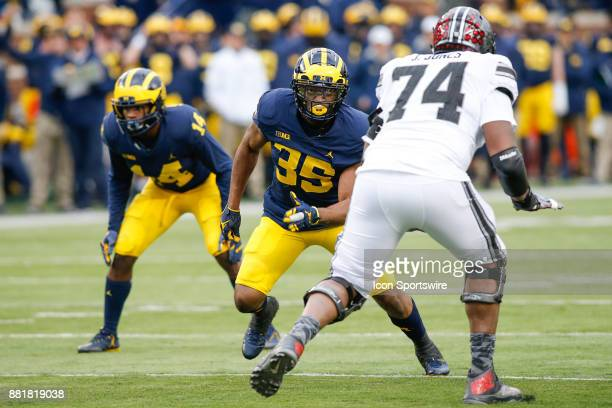 Michigan Wolverines linebacker Josh Uche plays defense during game action between the Ohio State Buckeyes and the Michigan Wolverines on November 25...