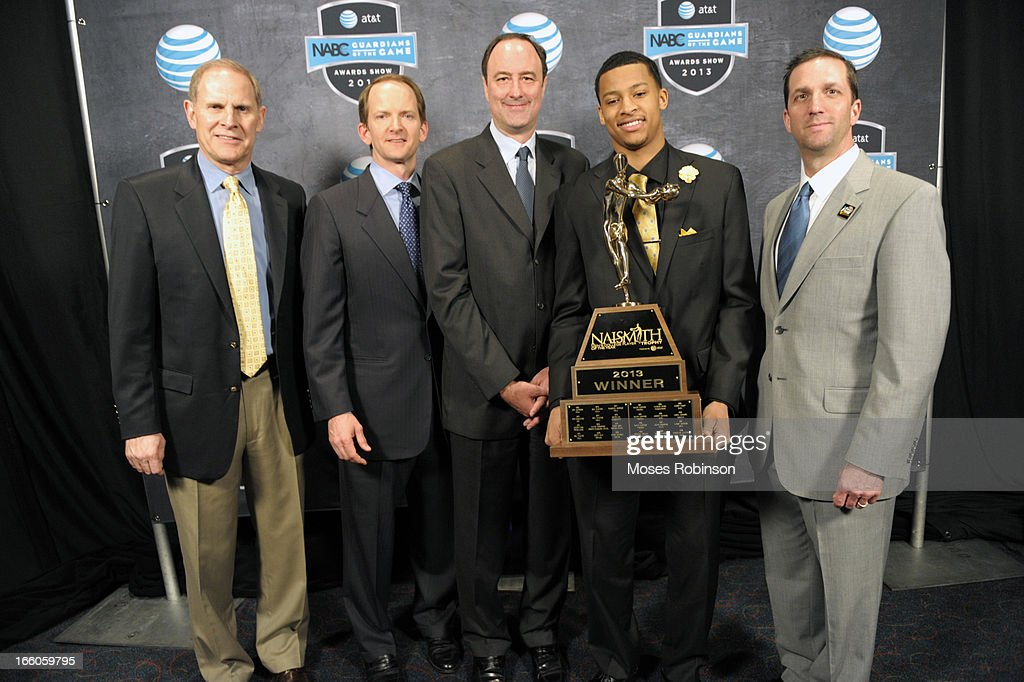 Michigan Wolverines Men's basketball Coach, John Beilein, AT&T CMO David Christopher, Chairman of the Atlanta Tipoff Club Barry Goheen, Trey Burke and Executive Director of the Atlanta Tipoff Club Eric Oberman pose with the 2013 Naismith Trophy at the NABC Guardians of the Game Awarding of the Naismith Trophy Presented by AT&T at Georgia World Congress Center on April 7, 2013 in Atlanta, Georgia.
