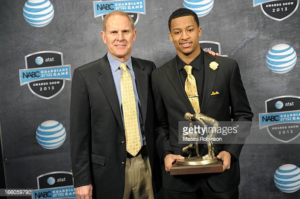 Michigan Wolverines Men's basketball John Beilein and Trey Burke pose with the 2013 Naismith Trophy at the NABC Guardians of the Game Awarding of the...
