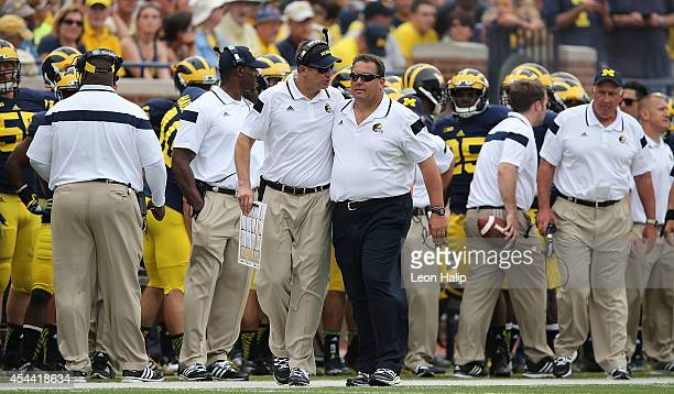 Michigan Wolverines offensive coordinator Doug Nussmeier and head football coach Brady Hoke talk on the sidelines during the second half of the game...