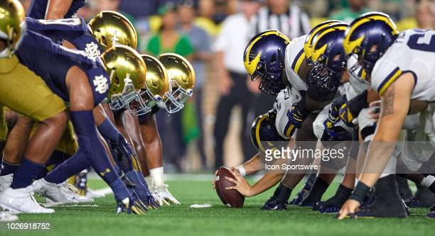 Michigan Wolverines offensive line lines up across from Notre Dame Fighting Irish defensive line at the line of scrimmage in game action during the...