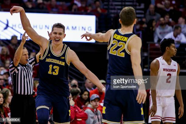 Michigan Wolverines player Moritz Wagner celebrates making a 3 point shot at the buzzer during an college basketball game between Michigan Wolverines...