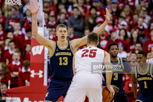 Michigan Wolverines player Moritz Wagner gets his hands up on defense on Wisconsin Badger forward Alex Illikainen during an college basketball game...