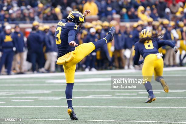 Michigan Wolverines punter Brad Robbins punts during a regular season Big 10 Conference game between the Ohio State Buckeyes and the Michigan...