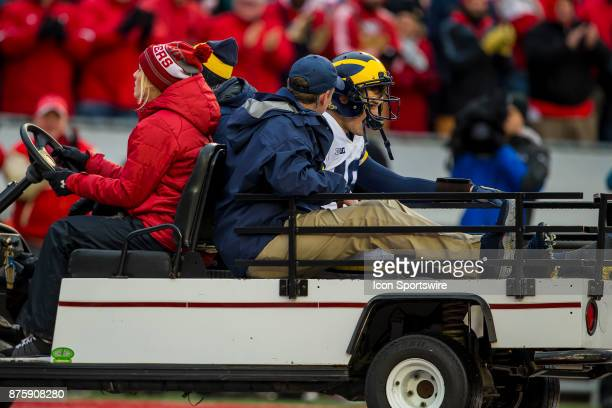 Michigan Wolverines quarterback Brandon Peters gets carted off the field after taking a hard hit durning an college football game between Michigan...