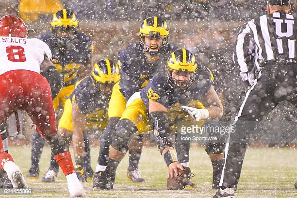 Michigan Wolverines quarterback John O'Korn calls signals during a long snow squall during the NCAA football game between the Indiana Hoosiers and...