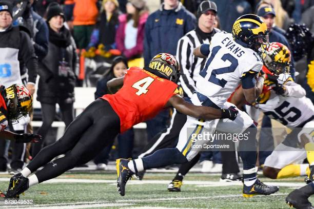 Michigan Wolverines running back Chris Evans runs a for a long gain in the fourth quarter against Maryland Terrapins defensive back Darnell Savage Jr...