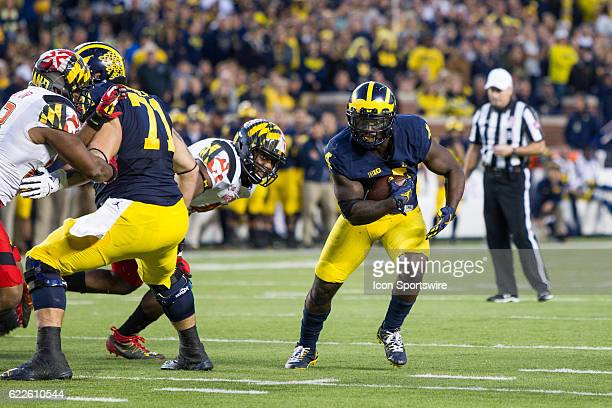 Michigan Wolverines running back De'Veon Smith runs with the ball during game action between the Maryland Terrapins and the Michigan Wolverines on...