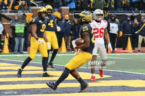 Michigan Wolverines running back Hassan Haskins runs into the end zone for a touchdown during a regular season Big 10 Conference game between the...