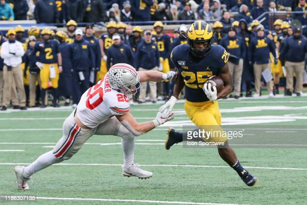 Michigan Wolverines running back Hassan Haskins runs with the ball against Ohio State Buckeyes linebacker Pete Werner during a regular season Big 10...