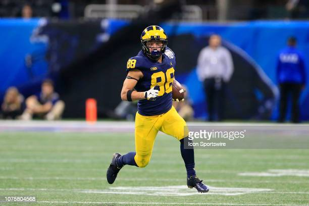 Michigan Wolverines wide receiver Grant Perry looks at the open field during the Peach Bowl between the Florida Gators and the Michigan Wolverines on...