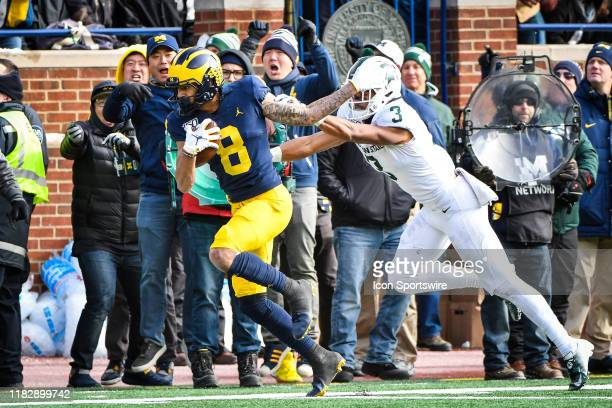 Michigan Wolverines wide receiver Ronnie Bell catches a pass over his shoulder in the middle of the field and runs for a long gain and is pushed out...