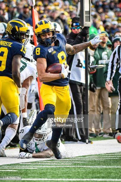 Michigan Wolverines wide receiver Ronnie Bell makes his way down the sidelines after a catch during the Michigan Wolverines versus Michigan State...