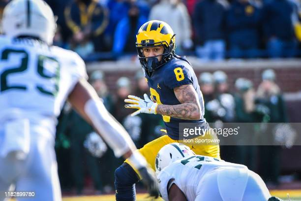 Michigan Wolverines wide receiver Ronnie Bell runs wide with a catch during the Michigan Wolverines versus Michigan State Spartans game on Saturday...