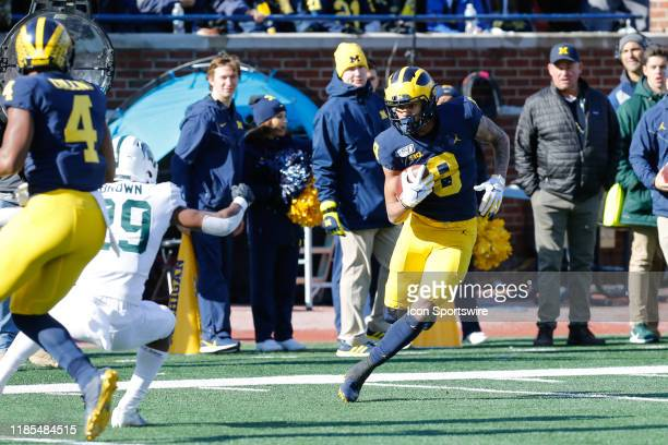 Michigan Wolverines wide receiver Ronnie Bell runs with the ball after catching a pass during a regular season Big 10 Conference game between the...