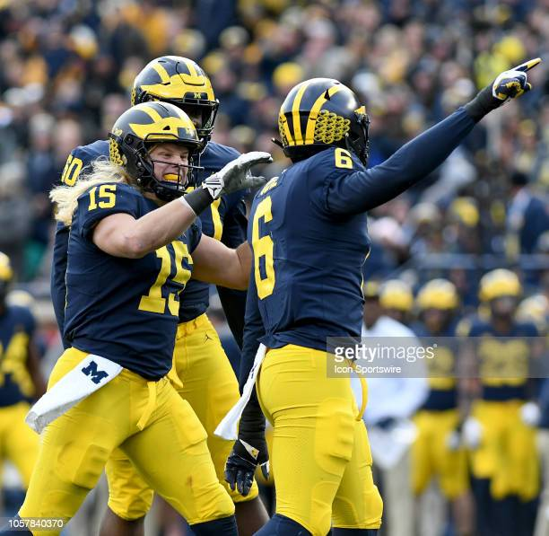 Michigan's Chase Winovich left celebrates with teammate Josh Uche after a tackle for a loss during a college football game against Penn State...
