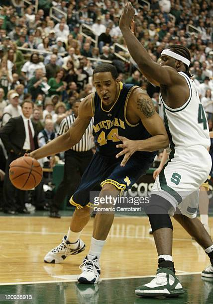 Michigan's Courtney Sims goes up against Marquise Gray Shannon Brown scored 26 points and No 16 Michigan State remained unbeaten at home with a 9071...