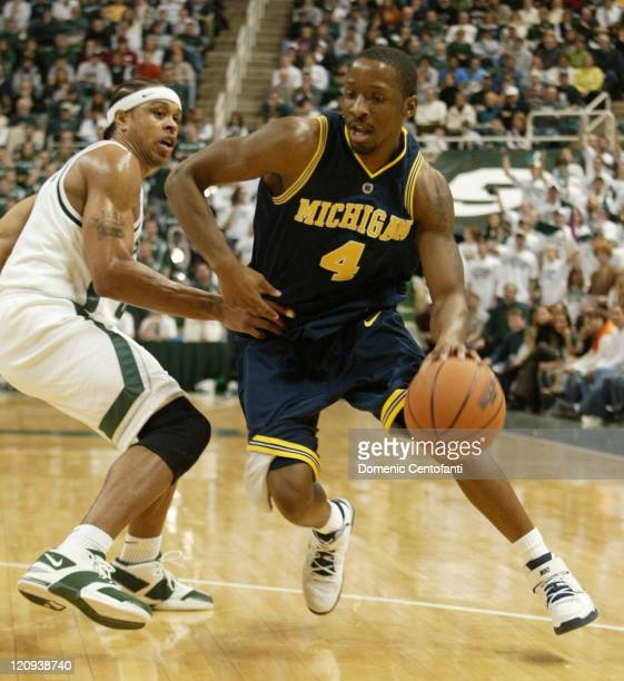 Michigan's Daniel Horton drives around Shannon Brown Shannon Brown scored 26 points and No 16 Michigan State remained unbeaten at home with a 9071...