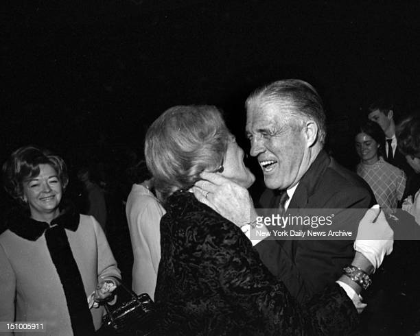 Michigan's Gov George Romney has a hug for Florence Knudsen of Detroit at governors reception She is the wife of Semon Knudsen president of Ford...