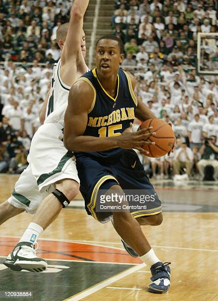 Michigan's Jevohn Shepherd drives around Drew Neitzel . Shannon Brown scored 26 points and No. 16 Michigan State remained unbeaten at home with a...