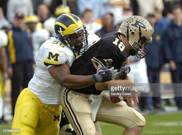 Michigan's LaMarr Woodley tackles Purdue quarterback Kyle Orton and forces a fumble in the 2nd quarter Michigan beat Purdue 1614 at RossAde Stadium W...