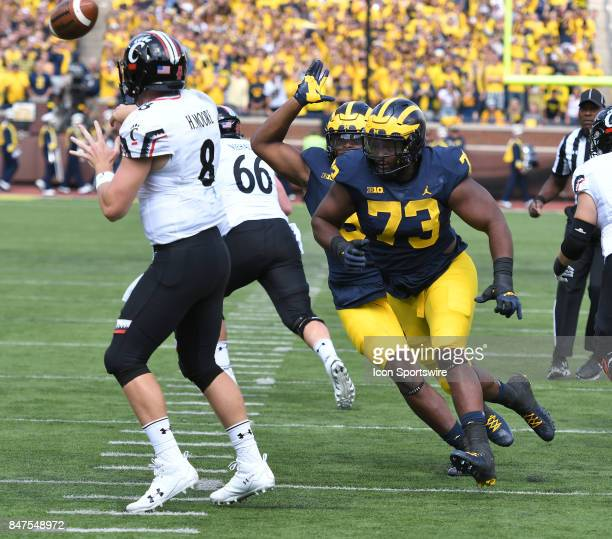 Michigan's Maurice Hurst pressures Cincinnati quarterback Hayden Moore during a college football game between the Cincinnati Bearcats and the...