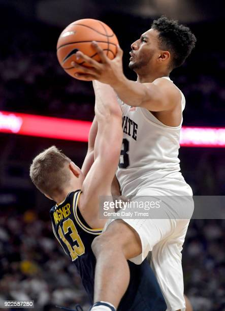 Michigan's Moritz Wagner left can't stop Penn State's Josh Reaves as he goes in for a layup on Wednesday Feb 21 at the Bryce Jordan Center in...