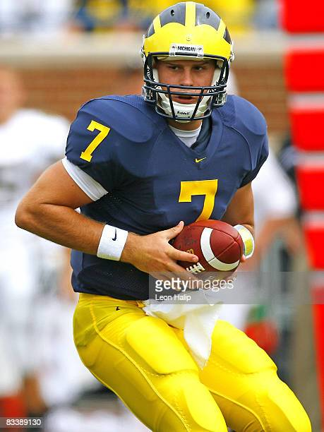 Michigan's quarterback Chad Henne hands off the ball in the first quarter versus Vanderbilt at Michigan Stadium Ann Arbor Michigan September 2 2006...