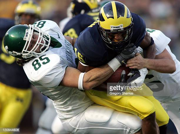 Michigan's Steve Breaston is tackled by Michigan State's Matt Walters at Michigan Stadium on October 30 2004 Michigan won the game 4537 in triple...