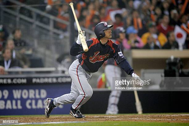 Michihiro Ogasawara of Japan drives home two runs as he reaches on a fielding error by Cuban center fielder Yoennis Cespedes during the 2009 World...