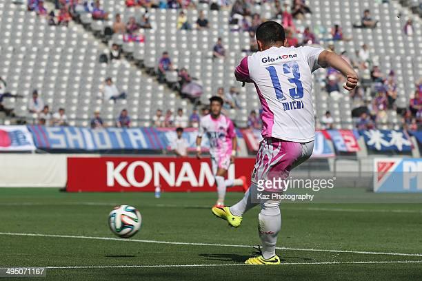 Michihiro Yasuda of Sagan Tosu scores his team's first goal during the JLeague Yamazaki Nabisco Cup Group A match between FC Tokyo and Sagan Tosu at...