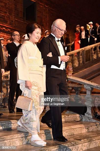 Michiko Kajita and King Carl XVI Gustaf of Sweden attend the Nobel Prize Banquet 2015 at City Hall on December 10 2015 in Stockholm Sweden