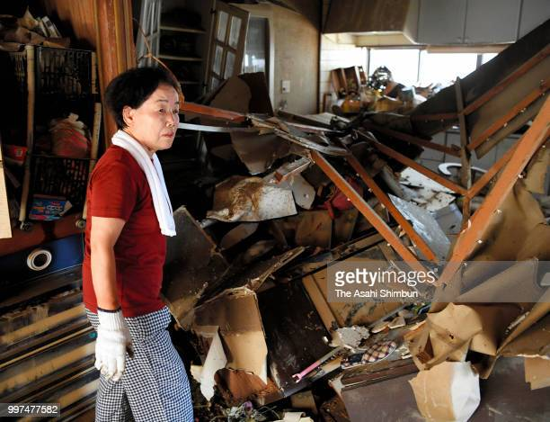 Michiko Kanzaki stands at a kitchen of her destroyed home on July 13 2018 in Kurashiki Okayama Japan The death toll from the torrential rain in...